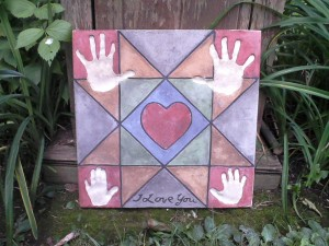 "childrens handprints 16"" square"
