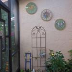 """16"""" diameter designs hung up in atrium"""