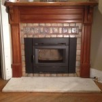 Mercer tile fireplace surround with marble slab hearth